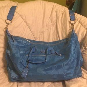 Light blue Coach duffle bag
